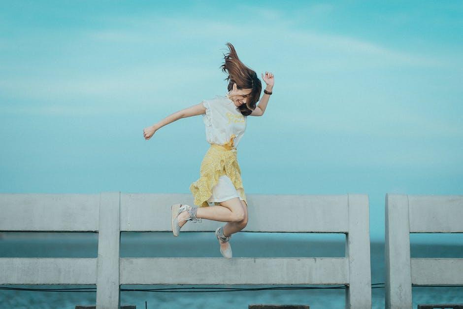 Happy Girl Jumping- IWD